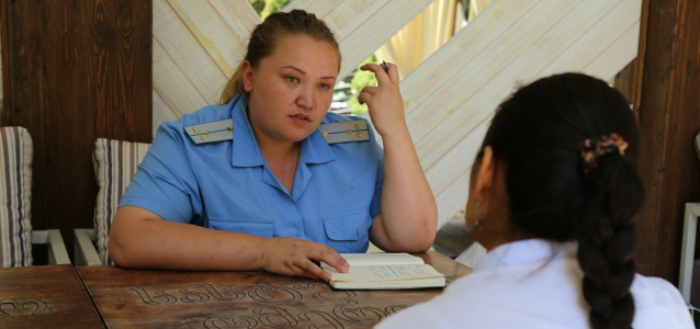 A representative of General Prosecutor's Office listens to a survivor of domestic violence. Photo: UN Women Kazakhstan/Aijamal Duishebaeva