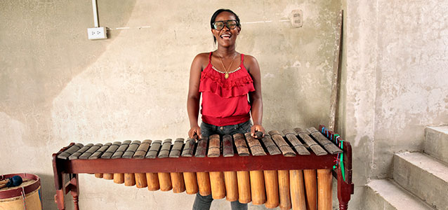 Mila Rodriguez with her Marimba. Photo: UN Women/Ryan Brown