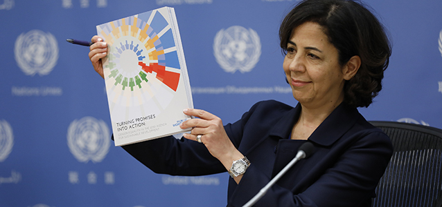 UN Women Chief of Research and Data Shahra Razavi holds up UN Women's new flagship report. Photo: UN Women/Ryan Brown