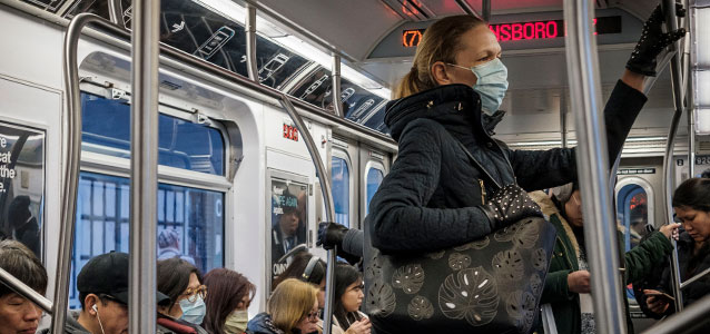 A woman on public transit in New York wears face mask in March 2020, when many appear to be doing so as a precaution against COVID-19. Photo: UN Photo/Loey Felipe