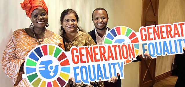 UN Women staff hold up Generation Equality signs