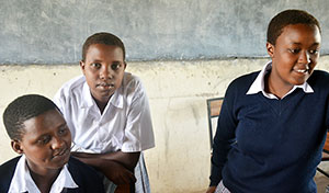 At the MWEDO girls' school near Arusha, girls like (left to right) Narau Kimani, Rhoda Bakari and Naserian Elikana avoid the scourge of female genital mutilation and child marriage.