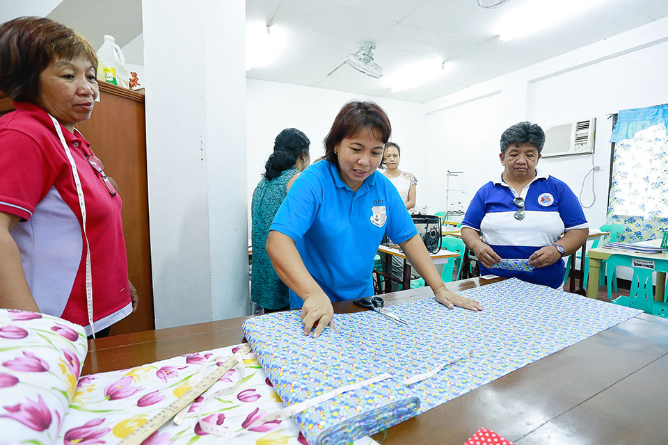 Delilah Dulay, 40, works as a master cutter at the Aringay Bannuar Garments Production