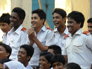 At a theatrical performance in Jessore, Bangladesh, in November 2012, a group of young men applaud as male characters are challenged for committing domestic violence.