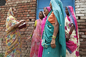 Savita Sharma, one of six human rights defenders trained by UN Women, speaks to widows on 17 June, 2013 in Vrindavan, India. Thanks to her work, 62 widows recently received their widows' pension.