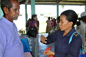 Sergeant Amelia de Jesus Amaral, a police officer in rural Timor-Leste, explains to customary leader Norberto Tomas why it is important to report every single case of domestic violence.