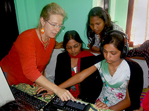 Bianca Miglioretto explaining studio operation to Nepalese women community radio broadcasters during a training session in Chitwan, 2011. Photo credit: Sarina/Community Radio Vijaya FM101.6