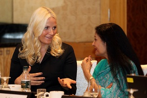 Norway's Crown Princess Mette-Marit (L) talks with Lakshmi Puri (R) during a Breakfast meeting at the Woman Deliver conference in Kuala Lumpur on 29 May, 2013. Photo Credit UN AIDS