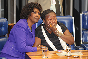 Congresswoman Benedita da Silva (left), author of the Constitutional amendment that expands rights for domestic workers, comforts Creuza Maria de Oliveira (right), President of the National Federation of Domestic Workers in Brazil, as the reform was enacted by Congress on 2 April 2013. Photo credit: Agência Brasil/José Cruz