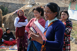 Kalpana Giri speaks with women migrant workers during a field visit to Satungal, Nepal.