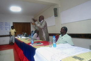 Tom Onyach, of the Luo Council of Elders, speaks at a workshop where community elders drafted a community cultural practice guidebook in an effort to emphasize the role of customary law in fighting disinheritance among widows. Photo courtesy of GROOTS International