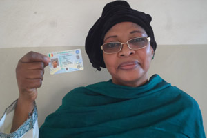 Traoré Nana Sissako, president of the women's oversight platform for Mali's elections, displays her National Identification Number voter card.