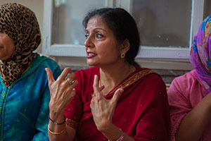 UN Women Deputy Executive Director Lakshmi Puri speaks with women survivors of violence at the Nejma Centre in Rabat on 1 October 2013, during a visit to Morocco to speak at the Fourth Congress and World Summit of Local and Regional Leaders organized by the United Cities and Local Government. Photo: UN Women/Nabil el Asri