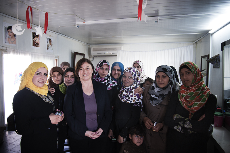 "The Director of UN Women's Programme Division, Gülden Türköz-Cosslett celebrates with the first Syrian women graduates of the ""Women and Girls Oasis"" programme at the Za'atari Refugee Camp, Jordan. Photo credit: Ventura Formicone"