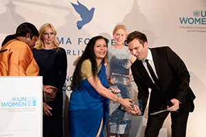 UN Women Goodwill Ambassador Nicole Kidman (left) speaks while ICC Prosecutor Fatou Bensouda (centre) and German actress Veronica Ferres (right) look on during the Cinema for Peace UN Women honorary dinner at Soho House on 12 July 2013 in Berlin.