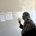 Iraq woman voeter consutling voting list