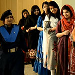 Pakistani women waiting in line to vote in a voting PSA
