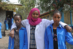 School gender-club members Eden and Abeba with the teacher and leader Lubaba at Woldia General Secondary School in the Amhara region of northern Ethiopia.   Photo: UN Women/ Kristin Ivarsson
