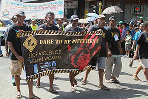 Street dwellers march for an end to violence against women as part of the Hibiscus Festival parade, August 2013. Photo: Foundation of the Peoples of the South Pacific International