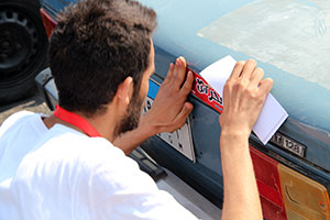 Off campus anti-sexual harassment campaign in which one of 6th of October University students put stickers on cars to promote the campaign's messages. Photo: 6th October University team