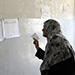 Iraqi woman looks at voting lists