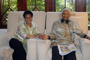 UN Women Executive Director Phumzile Mlambo-Ngcuka meets with Nelson Mandela.   Photo: Noah Selowe