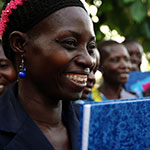 South Sudan woman holding notebook