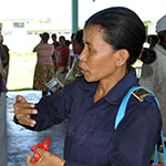 Timorese police officer speaking to community leader