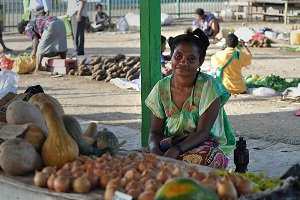A woman vendor in Gerehu market in Port Moresby, Papua New Guinea has benefited from safety improvements to the market infrastructure.
