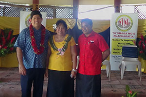 Lina Chang, President of Samoa Victim Support Group (centre), is flanked by representatives of two telecommunications companies, BlueSky and Digicel, at the launch of the help-line in April 2013. Photo: SVSG