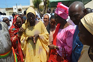 "Aminata Touré with Senegalese women during a field visit of ""justice houses"" in neighbourhoods with UN Women staff."