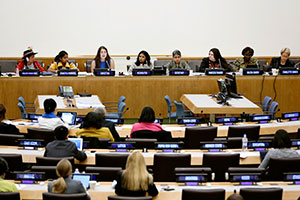 During a panel to give voice to civil society organizations, 17-year-old Christina, of the Working Group on Girls NGO, discusses what the Millennium Development Goals mean to her, with other women and girls. The panel took place on the second day of a UN Women Stakeholders' Forum in preparation for CSW58. Photo: UN Photo/Ryan Brown