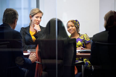 Former Representative for UN Women's Country Office in Mozambique, Valeria Campos Mello (left), translates for Raquelina. Photo: UN Women/Ryan Brown
