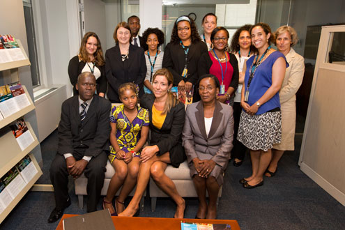 Raquelina and her colleagues pose for a photo with UN Women intergovernmental and programme staff. Photo: UN Women/Ryan Brown