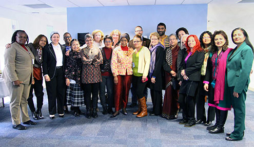 UN Women Executive Director Phumzile Mlambo-Ngcuka (front centre) and Deputy Executive Director Lakshmi Puri (far right), pose with members of UN Women's Global Civil Society Advisory Group, which met in New York on 12 February 2014.
