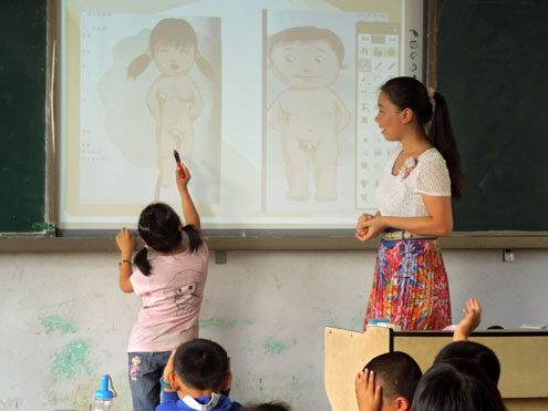 As part of student sexual safety training in Suizhou, central China, a 6-year-old girl circles the private parts of a human body after having learned how to identify them on female and male human bodies. Photo: Xinyu Zhang
