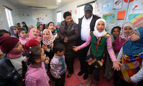 UN Women Executive Director Phumzile Mlambo-Ngcuka and UN Resident and Humanitarian Coordinator in Jordan Edward Kallon visit Zaatari refugee camp for Syrian refugees during her trip to Jordan from 20 to 23 February 2014. Photo: UN Women Jordan/Abdullah Ayoub
