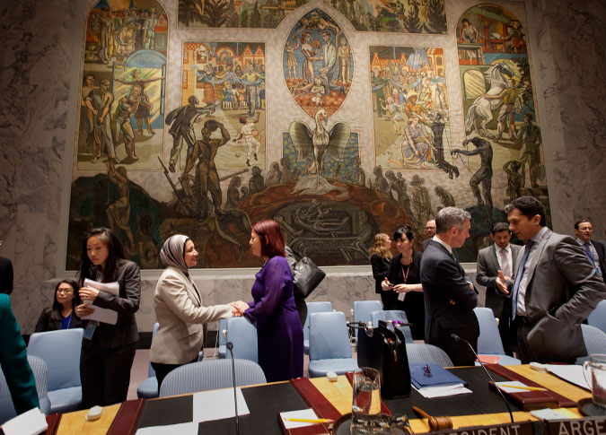 Prior to the opening of the open debate, Suaad Allami greets María Cristina Perceval, Permanent Representative of Argentina to the UN and President of the Security Council for October. Photo: UN Women/Ryan Brown