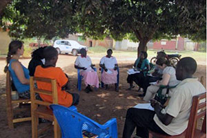 A team from UN Women meets with the Gulu Union of Women with Disabilities during a visit by the Global Manager of the UN Women Peace and Security Programme. The Union is a women-led grassroots organization that has been a beneficiary of the programme since 2011. Photo courtesy of GUWODU.