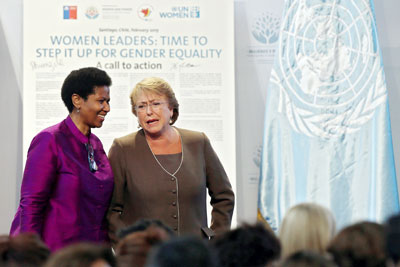 "UN Women Executive Director Phumzile Mlambo-Ngcuka and President of Chile Michelle Bachelet at the closing ceremony of the high-level event on ""Women in power and decision-making: Building a different world,"" held in Santiago, Chile, on 27–28 February 2015. (Photo: UN Women/Mario Ruiz.)"