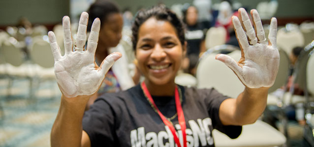 At a Women's Gathering on 8 March 2015 in the Department of Meta, participants planted their hands painted in white on a mural as a symbol of their desire to make a mark for peace. Photo: UN Women/ Mauricio Cardona