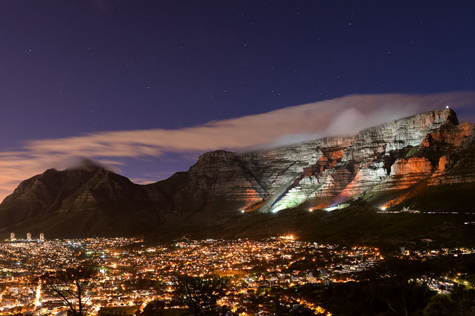 Cape Town, South Africa's Table Mountain was lit orange on 25 November to raise awareness about violence against women. Photo: City of Cape Town/Bruce Sutherland