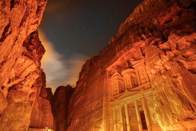 The UNESCO World Heritage archeological site of Petra, in Jordan, was lit in orange on 25 November. Photo: UN Women/Christopher Herwig