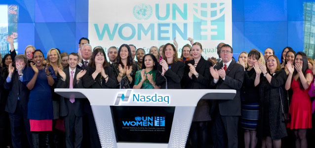 UN Women Deputy Executive Director Lakshmi Puri (centre) and dozens of UN, government and global business leaders, took part in the Ring the Bell ceremony at the NASDAQ Stock Exchange on 9 March. Photo: UN Women/Ryan Brown