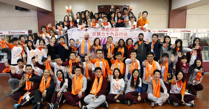 Students at Beijing Normal University and Beijing Royal School wore orange to spread messages on ending violence against women. Photo: UN Women