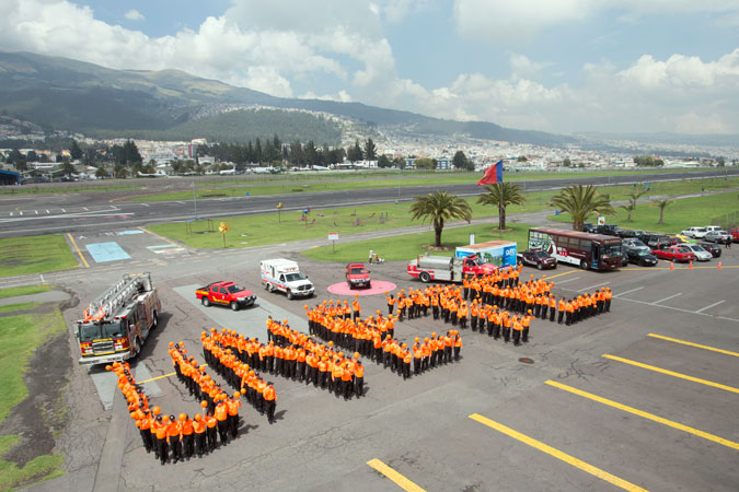"Firefighters in Quito, Ecuador, call for everyone to become part of the ""Orange the world"" effort to end violence against women by spelling out the word UNiTE (""Únete"" in Spanish). Photo: UN Women/Martin Jamarillo"