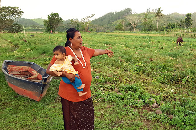 Raj Wati showing part of her farm that was destroyed by flooding. Photo: Kasanita Isimeli.