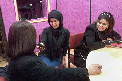 In the studio of Radio Voix de Femmes, Nafisa Lahreche hosts a talk with Ben Torki Oumsaad, MP and activist within the province of Algiers, and Kheira Bounaadja, a political activist and former official of the Department of Research and Education. Photo courtesy of Radio Voix de Femmes