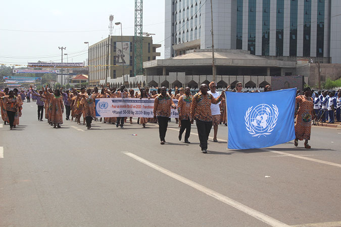 Women and men marched with banners, calling for gender equality and women's empowerment in Cameroon. Photo: UN Women