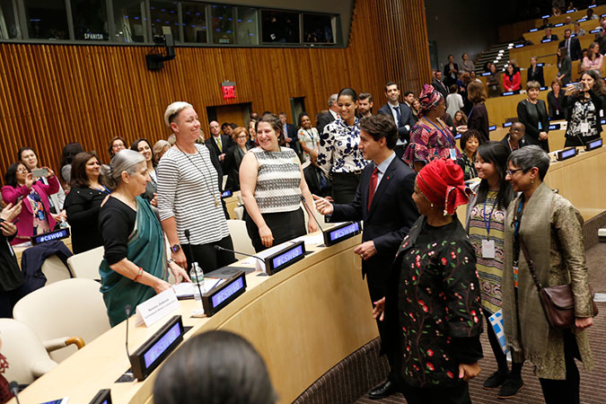 Canadian Prime Minister Justin Trudeau greets U.S. football icon Abby Wambach at UN Women's High-Level Event on Gender Equality and Global Call to Action on Equal Pay. Photo: UN Women/Ryan Brown